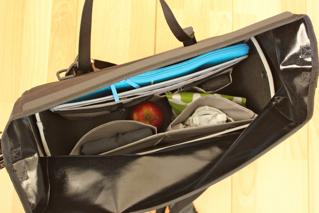 Bag With Laptop In Blue Sleeve Lunch And Various Other Items